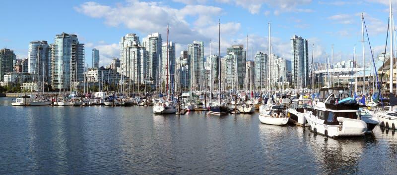 False Creek marina & the Vancouver skyline royalty free stock image