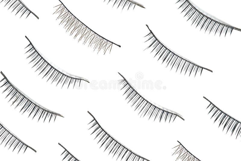 False eyelashes isolated on white background. Beautiful eyelash extensions. Flat lay stock image