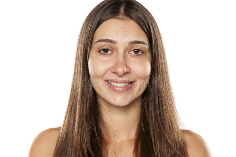 False smile. Beautiful young woman without makeup and with false smile royalty free stock photography