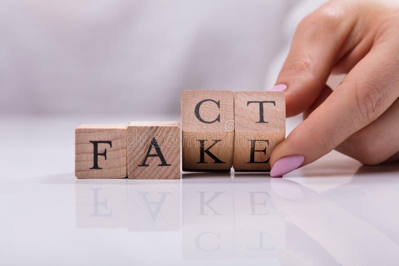 Falsificación de Replacing Blocks From de la empresaria a la palabra del hecho fotografía de archivo libre de regalías