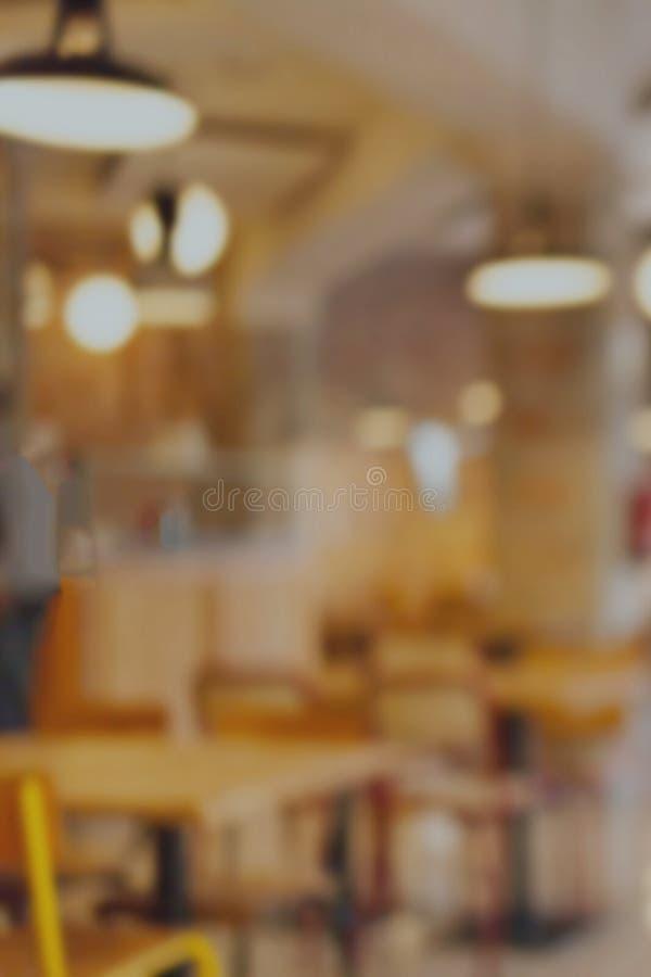 Falta de definición abstracta e interior defocused del restaurante, cafetería o fotografía de archivo