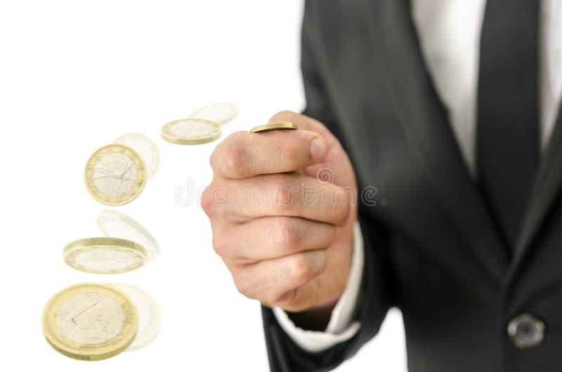 Falta de definición de movimiento de lanzar una moneda imagen de archivo libre de regalías