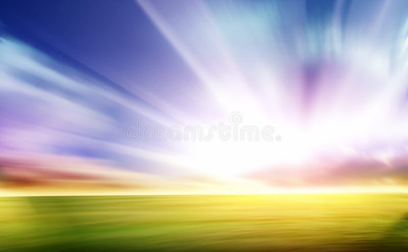 Falta de definici?n de movimiento de la hierba y del cielo azul fotografía de archivo