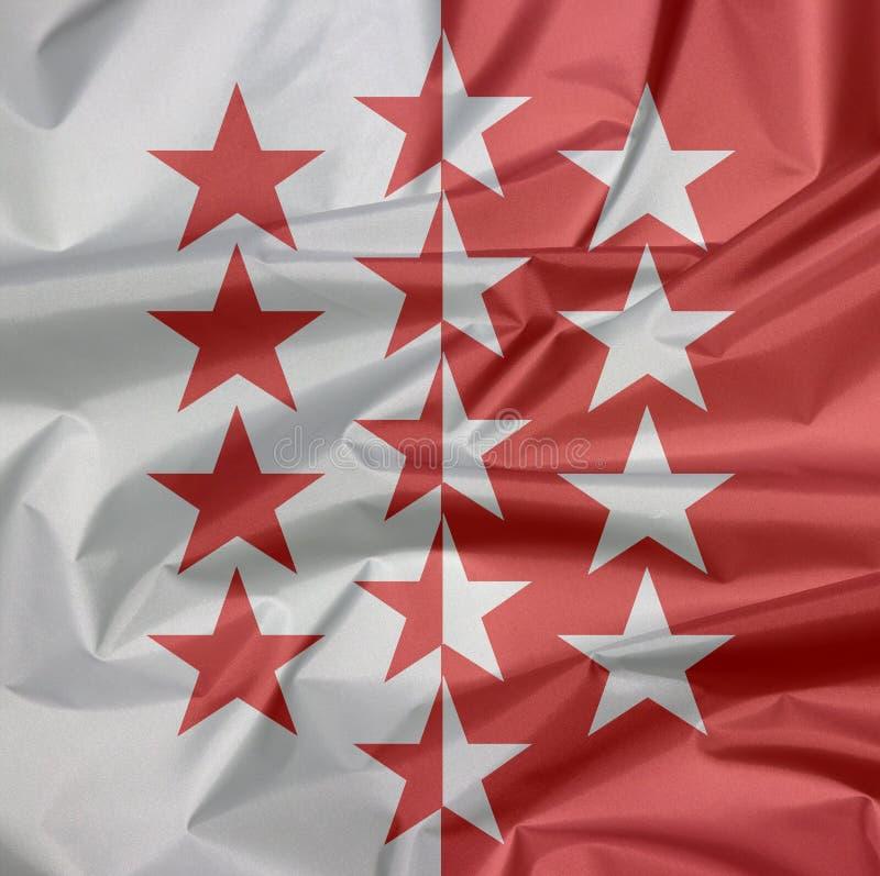 Falte des Wallis-Flaggenhintergrundes, der Bezirk von die Schweiz-Bündnis lizenzfreie stockfotos