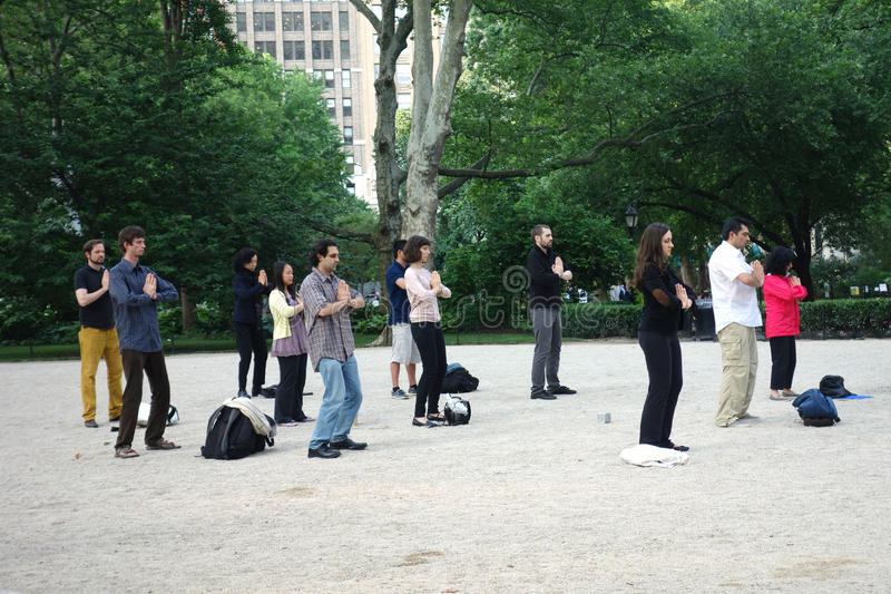 Falun Dafa. People practice the exercises of Falun Dafa in Madison Square Park, New York. Also known as Falun Dong, this is a Chinese spiritual discipline that stock photo