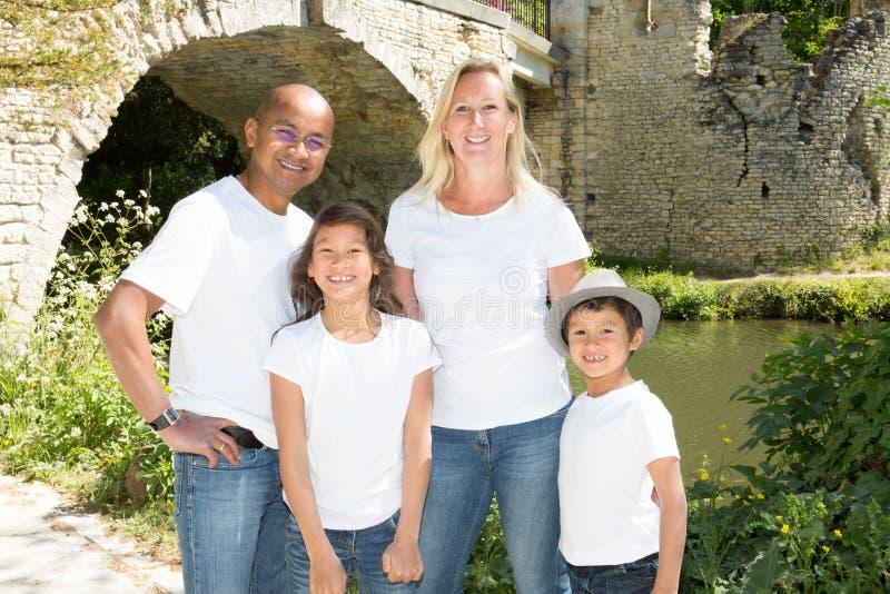 Família americana da raça misturada no parque imagem de stock royalty free