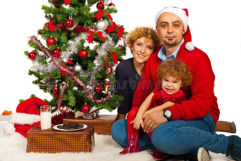A família bonita comemora o Natal fotos de stock
