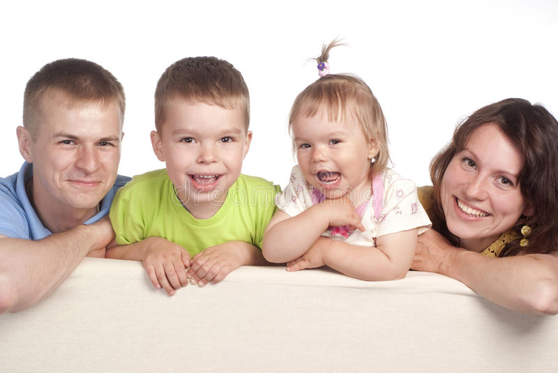 Família bonito no sofá imagens de stock