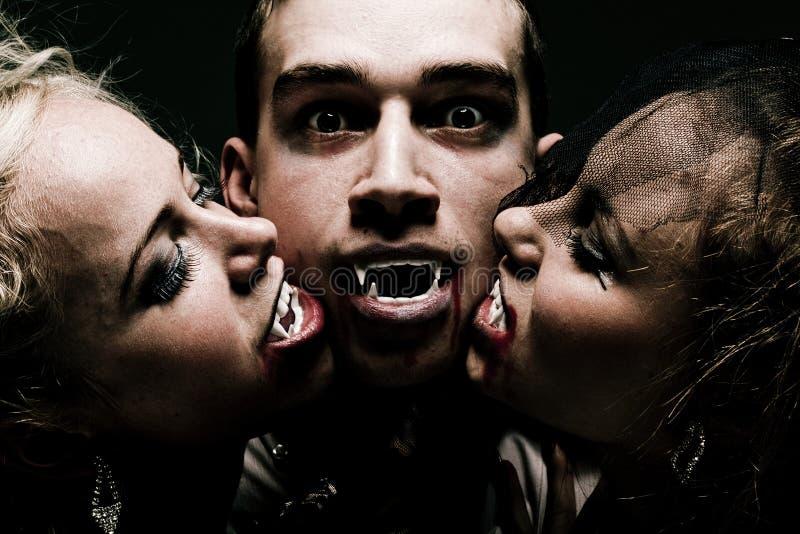 Família com fome do vampiro foto de stock