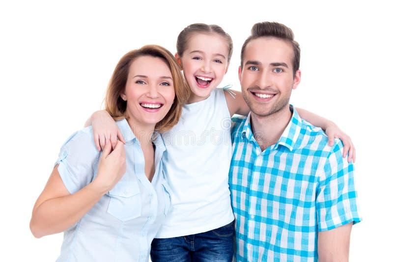 Família com menina e sorrisos consideravelmente brancos fotografia de stock