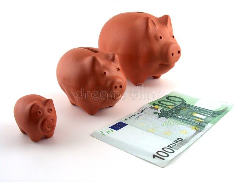 Família de caixas de dinheiro do porco fotos de stock