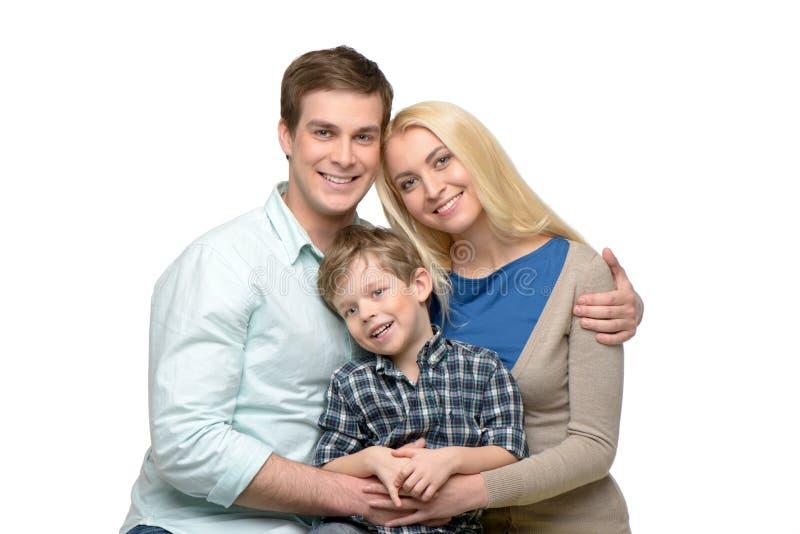 Família de sorriso do tempo três de apreciação junto imagem de stock royalty free