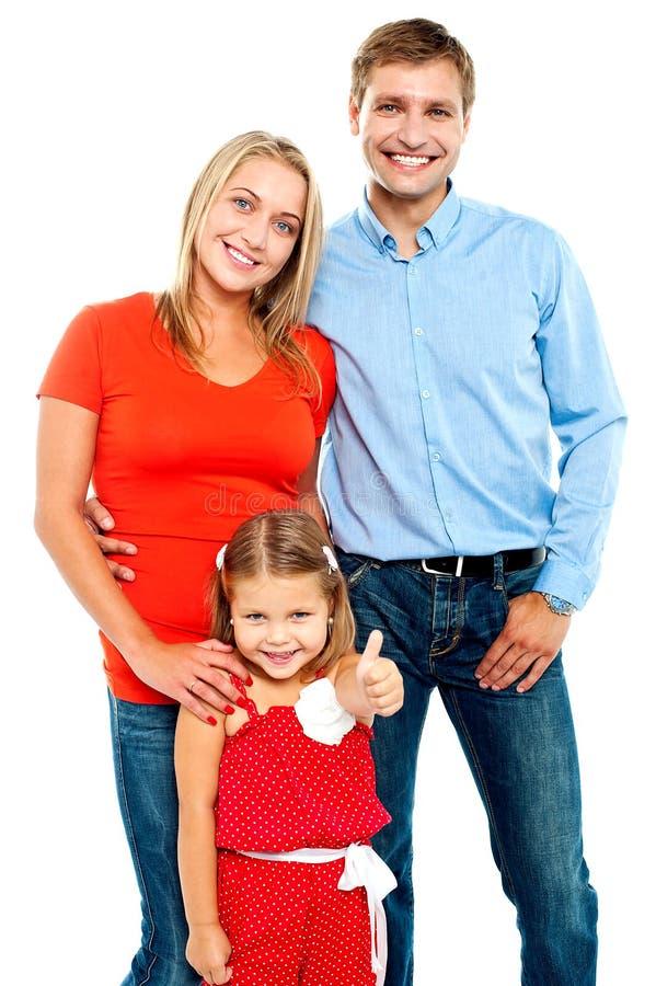 Família de sorriso em um fundo branco imagens de stock