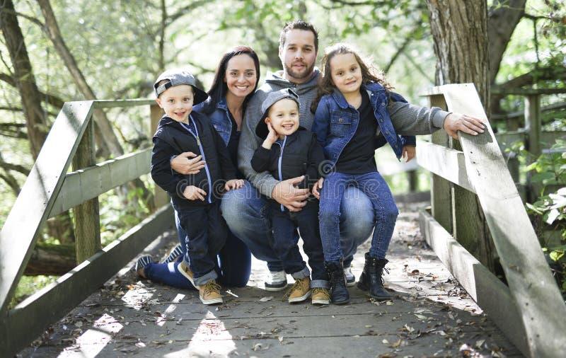 Família do membro cinco nas madeiras junto fotografia de stock royalty free