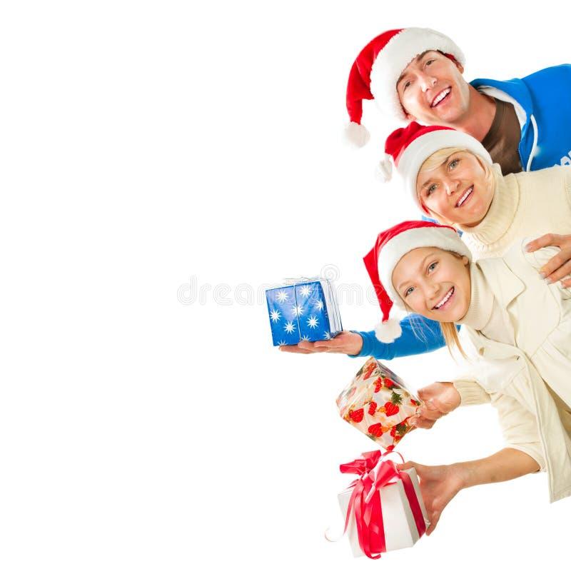 Família do Natal com presentes fotos de stock royalty free