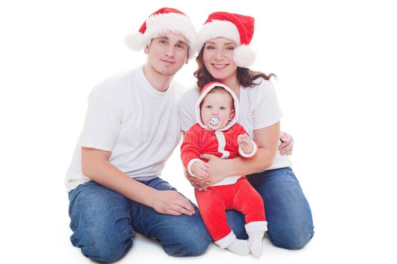 Família do Natal que olha a câmera imagem de stock royalty free