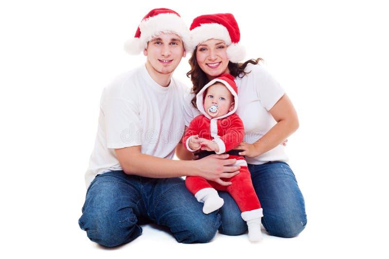 Família do Natal que senta-se no assoalho foto de stock
