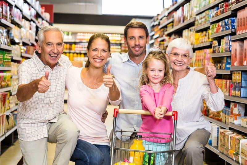 Família extensa feliz que mostra os polegares acima imagem de stock royalty free