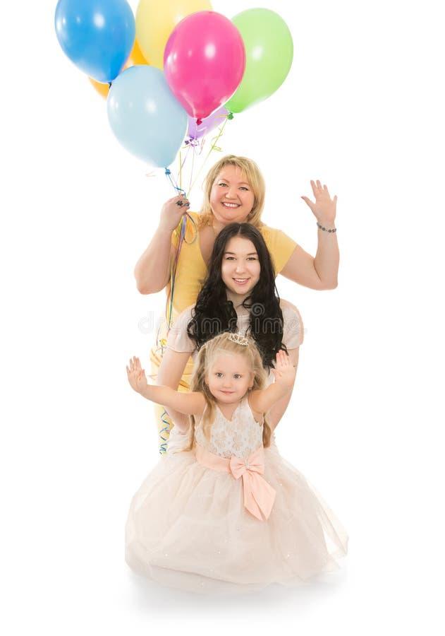 Família feliz com balões imagem de stock royalty free