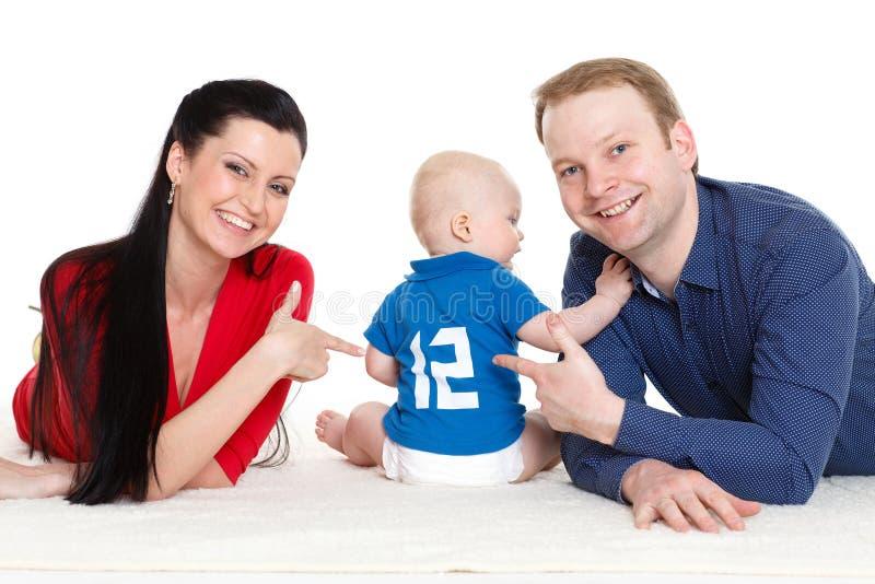 Família feliz com bebê. foto de stock royalty free