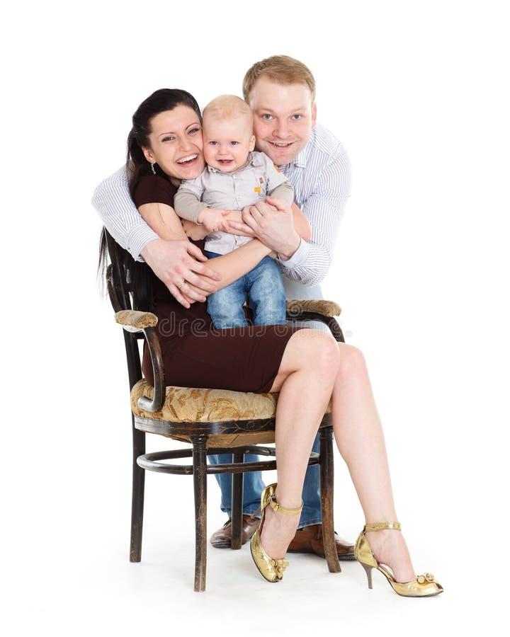 Família feliz com bebê. fotografia de stock royalty free