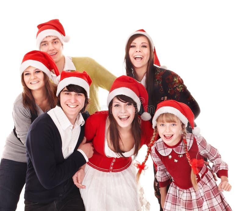 Família feliz com a criança no chapéu de Santa. fotografia de stock