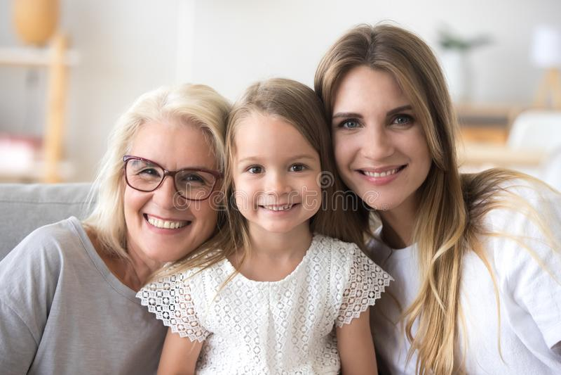 Família feliz da avó, da filha e da criança olhando o camer imagem de stock royalty free