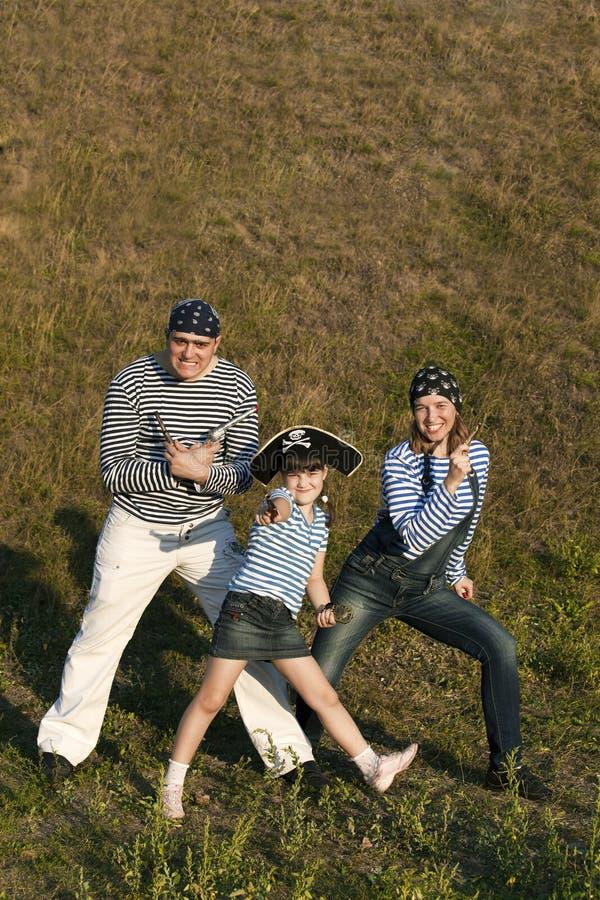 Família feliz do pirata foto de stock