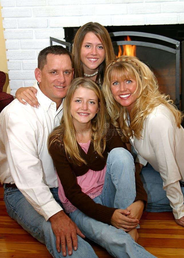 Família feliz em casa 2 fotografia de stock royalty free