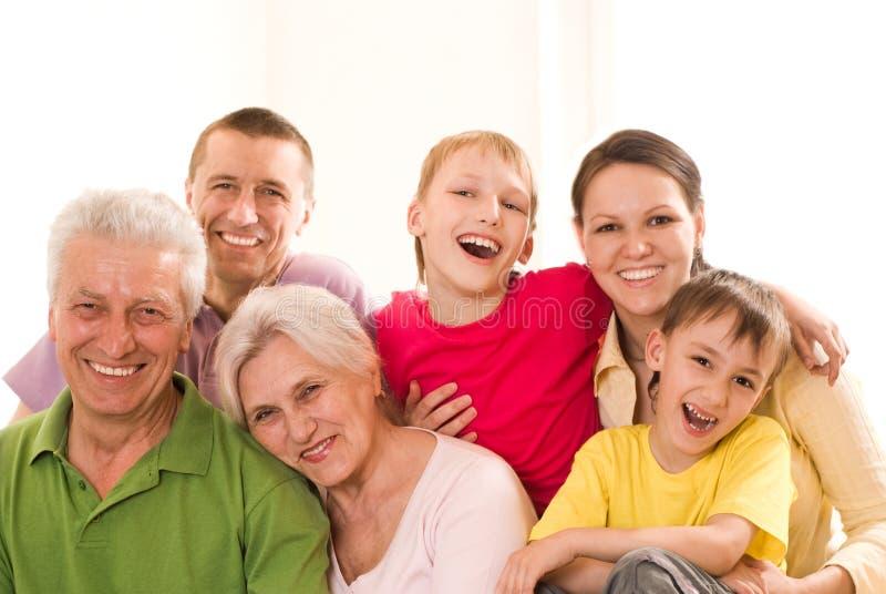 Família feliz em um branco imagens de stock