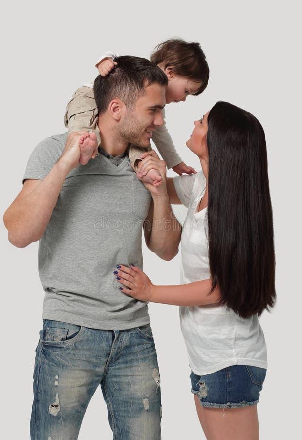 Família feliz em um fundo branco Mãe, pai e filho foto de stock royalty free