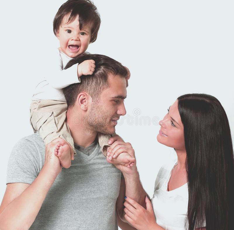 Família feliz em um fundo branco Mãe, pai e filho fotografia de stock royalty free
