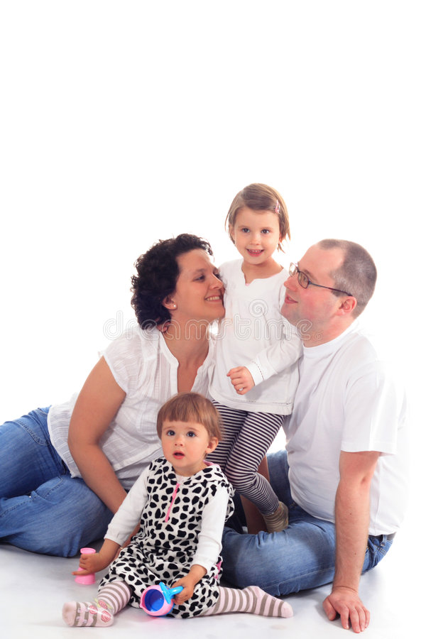 Família feliz isolada no branco imagens de stock royalty free