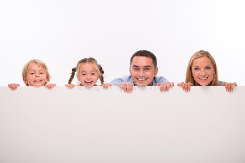 Família feliz isolada no fundo branco fotografia de stock