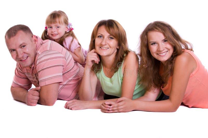 Família feliz. Matriz, pai e duas filhas fotos de stock royalty free