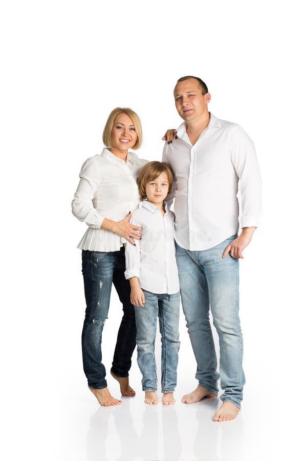 Família feliz no fundo branco fotografia de stock royalty free