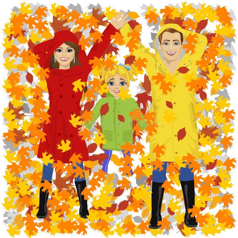 Família feliz nova da mãe e do pai da filha que encontram-se nas folhas de outono no parque ilustração royalty free