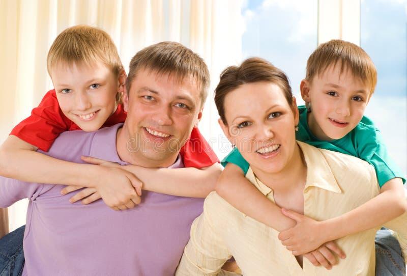 Família feliz quatro imagens de stock