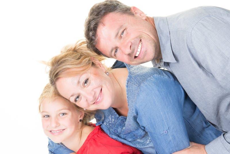 Família feliz que abraça sobre o fundo branco imagens de stock