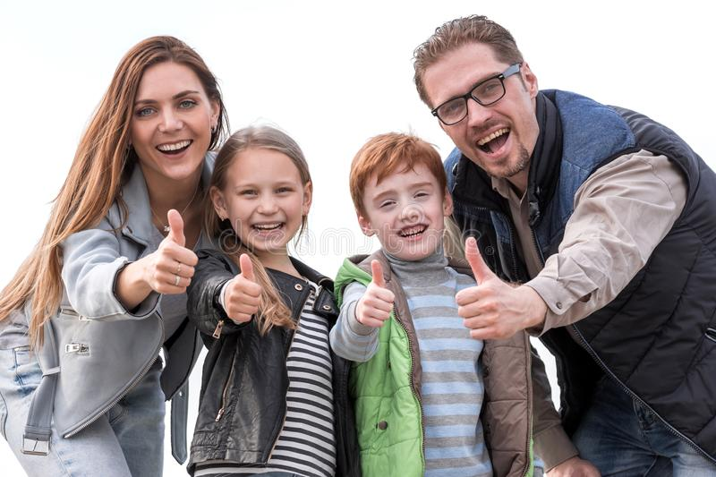 Família feliz que mostra os polegares acima fotos de stock royalty free