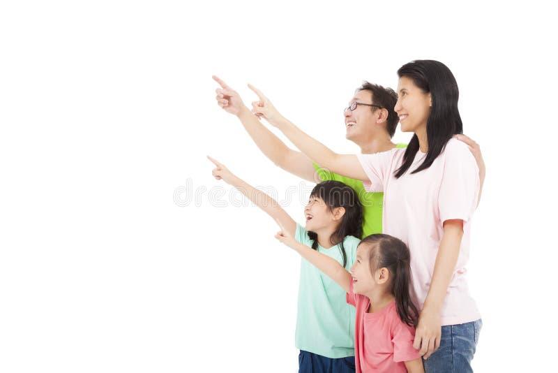 Família feliz que olha e que aponta fotografia de stock