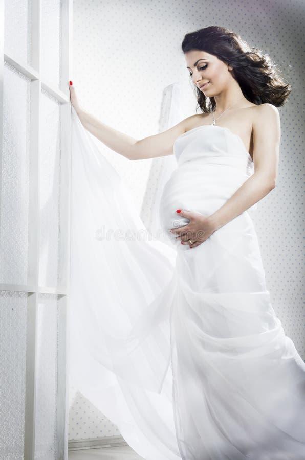 Família grávida nova bonita imagens de stock royalty free