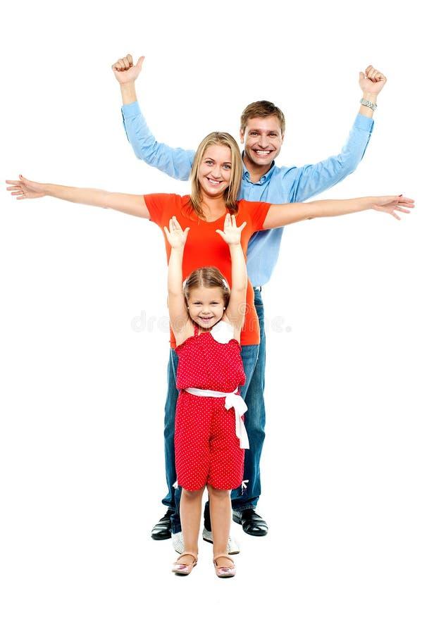 Família loving do divertimento. Retrato cheio do comprimento imagem de stock royalty free