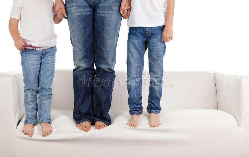 Família nas calças de brim fotografia de stock royalty free