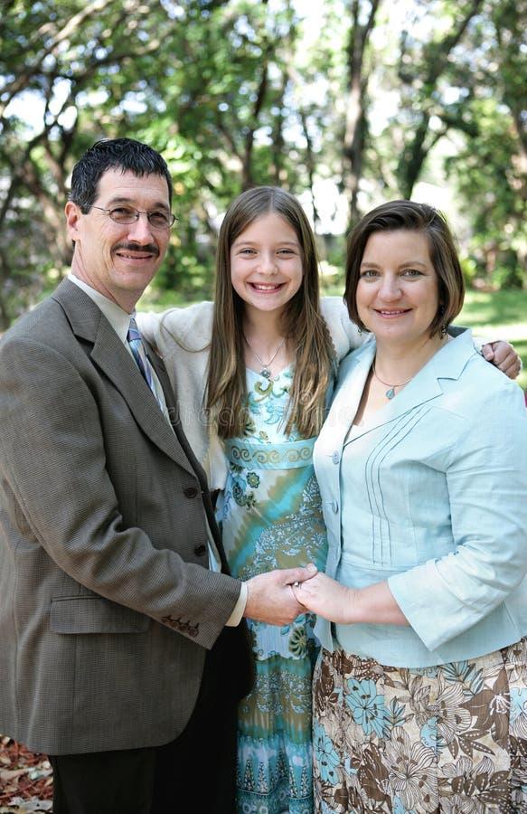 Família no vertical do parque fotografia de stock royalty free