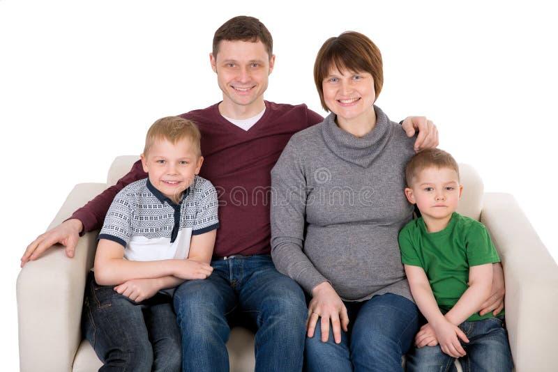 Família nova bonita com mãe grávida fotografia de stock royalty free