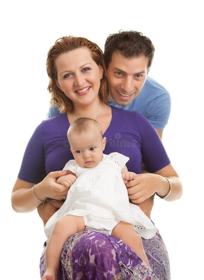 Família nova bonita no fundo branco foto de stock royalty free