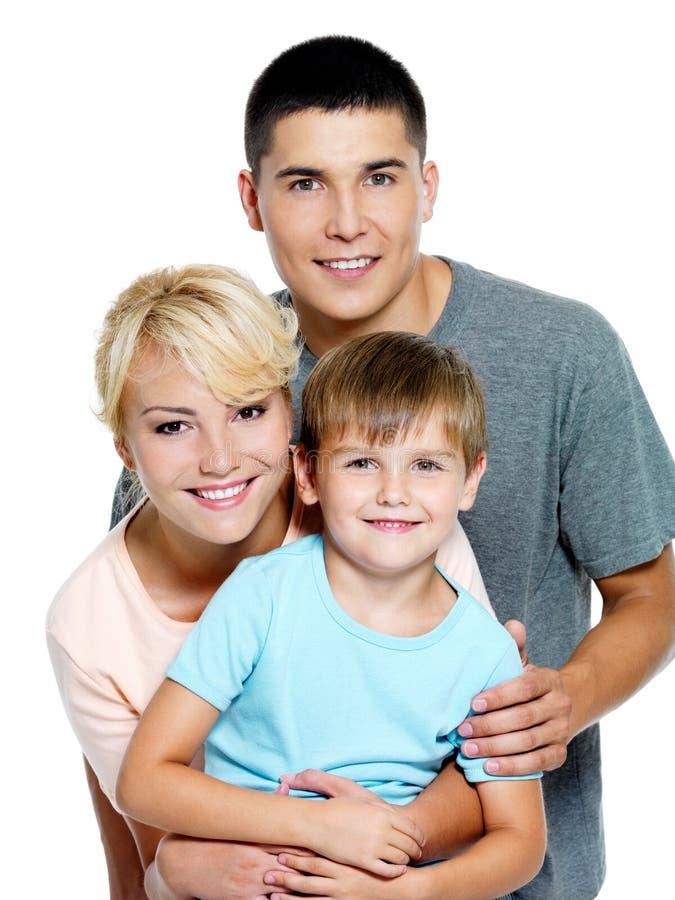 Família nova feliz com o filho de 6 anos fotos de stock royalty free