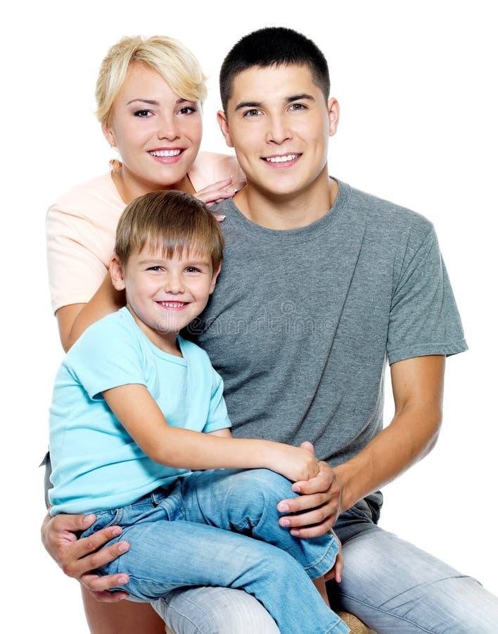 Família nova feliz com o filho de 6 anos imagens de stock royalty free