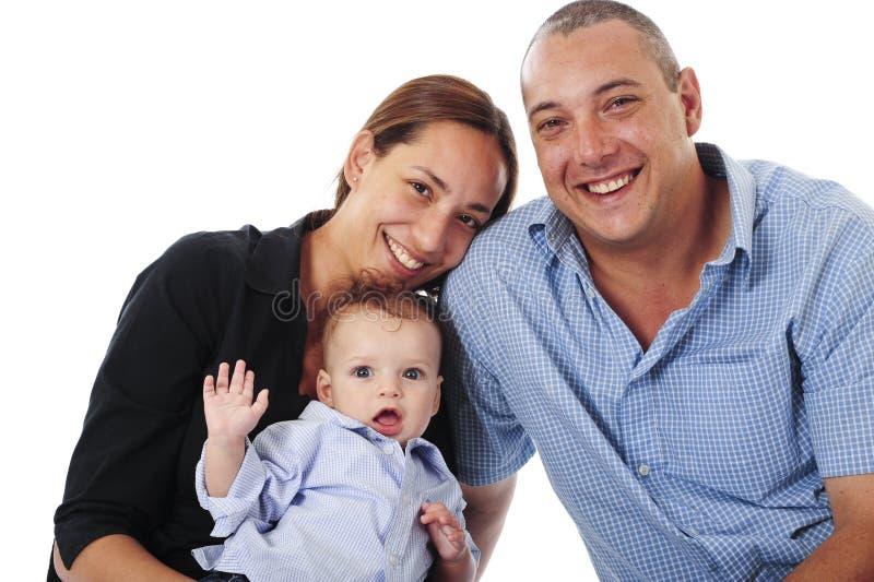 Família nova no estúdio imagens de stock
